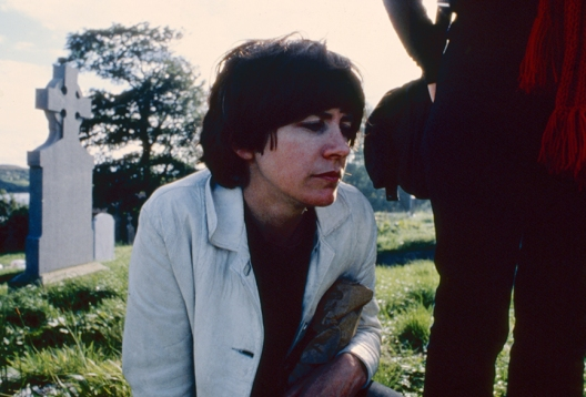 Nan Goldin, Vivienne at her mother's grave, Killybegs, Ireland, 1979, Archival pigment print mounted on Dibond, 76.2 x 114.3 cm. © Nan Goldin.